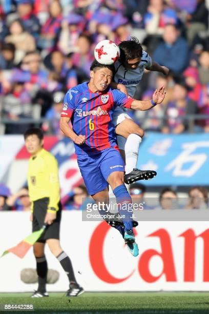 Yasuhito Endo of Gamba Osaka and Kosuke Ota of FC Tokyo compete for the ball during the JLeague J1 match between FC Tokyo and Gamba Osaka at...