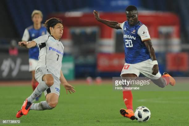 Yasuhito Endo of Gamba Osaka and Olivier Boumal of Yokohama FMarinos compete for the ball during the JLeague J1 match between Yokohama FMarinos and...