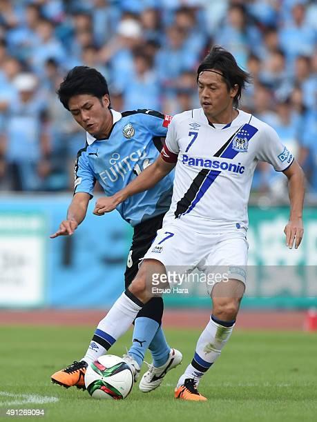 Yasuhito Endo of Gamba Osaka and Ryota Oshima of Kawasaki Frontale compete for the ball during the JLeague match between Kawasaki Frontale and Gamba...