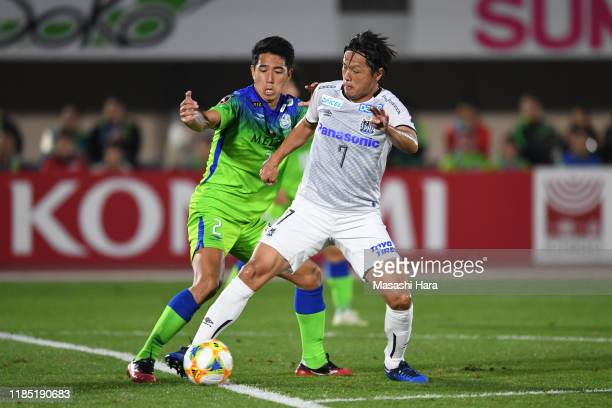 Yasuhito Endo of Gamba Osaka and Shunsuke Kikuchi of Shonan Bellmare compete for the ball during the J.League J1 match between Shonan Bellmare and...
