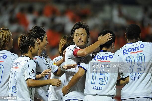 Yasuhito Endo of Gamba Osaka celebrates the first goal by Yasuyuki Konno during the J League match between Omiya Ardija and Gamba Osaka at the Nack 5...