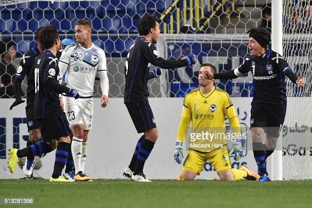 Yasuhito Endo of Gamba Osaka celebrates the first goal during the AFC Champions League Group G match between Gamba Osaka and Melbourne Victory at...