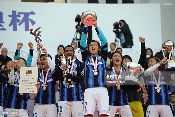 Yasuhito Endo of Gamba Osaka holds the cup after the 95th Emperor's Cup final between Urawa Red Diamonds and Gamba Osaka at Ajinomoto Stadium on...