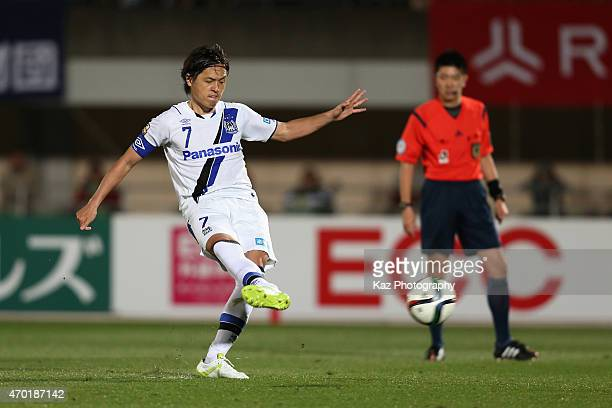 Yasuhito Endo of Gamba Osaka scores his team's second goal from a penalty spot during the J.League match between Shonan Bellmare and Gamba Osaka at...