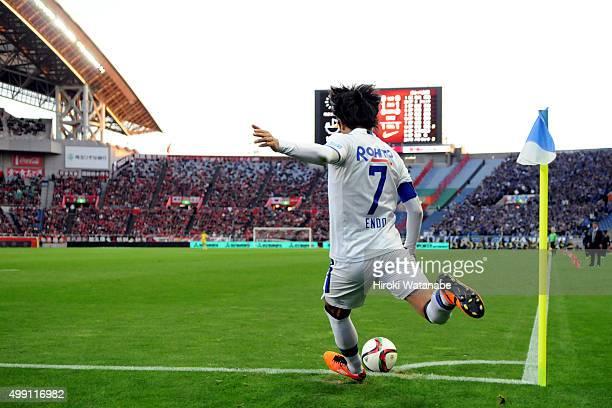 Yasuhito Endo of Gamba Osaka takes a corner kick during the JLeague 2015 Championship semi final match between Urawa Red Diamonds and Gamba Osaka at...