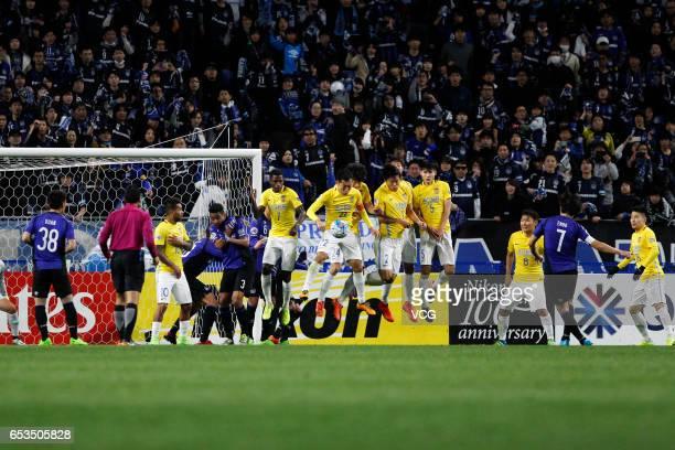 Yasuhito Endo of Gamba Osaka takes a free kick during the AFC Champions League Group H match between Gamba Osaka and Jiangsu Suning at the Suita City...