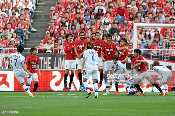 Yasuhito Endo of Gamba Osaka takes a free kick during the JLeague match between Urawa Red Diamonds and Gamba Osaka at Saitama Stadium on May 2 2015...