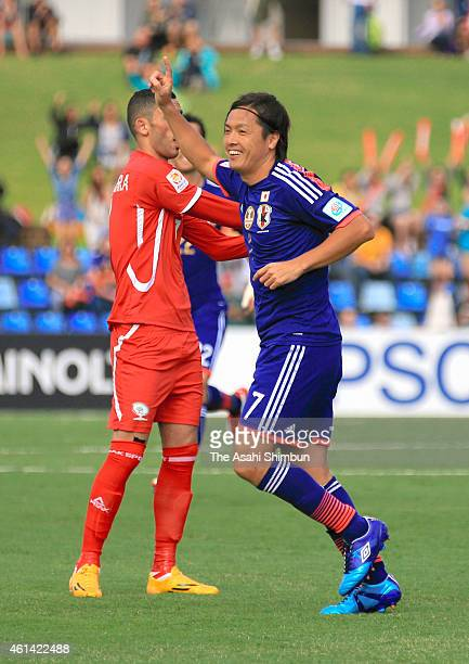Yasuhito Endo of Japan celebrates scoring his team's first goal during the 2015 Asian Cup match between Japan and Palestine at Hunter Stadium on...