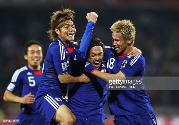 Yasuhito Endo of Japan celebrates scoring their second goal during the 2010 FIFA World Cup South Africa Group E match between Denmark and Japan at...