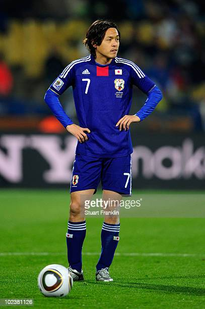 Yasuhito Endo of Japan prepares to take a free kick during the 2010 FIFA World Cup South Africa Group E match between Denmark and Japan at the Royal...