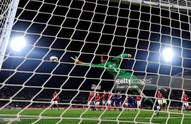 Yasuhito Endo of Japan scores his team's second goal from a free kick past Thomas Sorensen of Denmark during the 2010 FIFA World Cup South Africa...