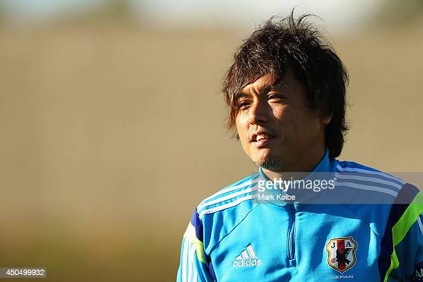 Yasuhito Endo watches on during a Japan training session at the Japan national team base camp at the Spa Sport Resort on June 12, 2014 in Itu, Sao...