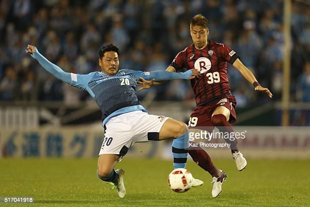Yasuhito Morishima of Jubilo Iwata and Masahiko Inoha of Vissel Kobe compete for the ball during the JLeague Yamazaki Nabisco Cup match between...