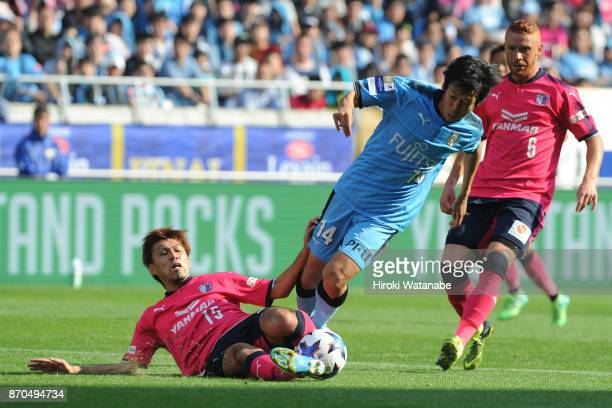 Yasuki Kimoto of Cerezo Osaka and Kengo Nakamura of Kawasaki Frontale compete for the ball during the JLeague Levain Cup final match between Cerezo...