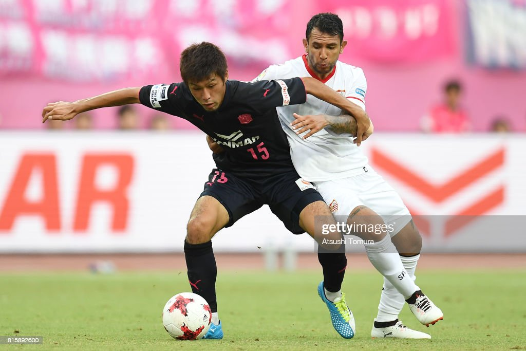 Yasuki Kimoto of Cerezo Osaka (L) and Walter Montoya Sevilla FC (R) compete for the ball during the preseason friendly match between Cerezo Osaka and Sevilla FC at Yanmar Stadium Nagai on July 17, 2017 in Osaka, Japan.