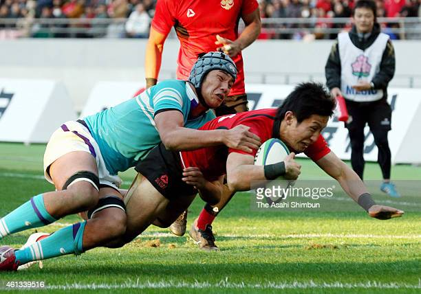 Yasunari Isoda of Teikyo scores a try during the 51st All Japan University Rugby Championship final match between Teikyo University and Tsukuba...