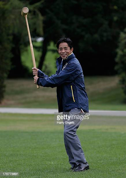 Yasunari Iwata from Japan riding for the 'Rest of the World' team jokes around with a croquet mallet during a photocall ahead of the Dubai Duty Free...