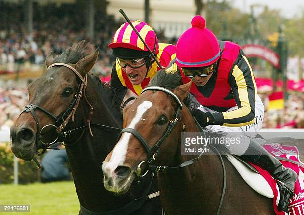 Yasunari Iwata riding Delta Blues leads Damien Oliver riding Pop Rock during the Emirates Melbourne Cup during The Melbourne Cup Carnival meeting at...