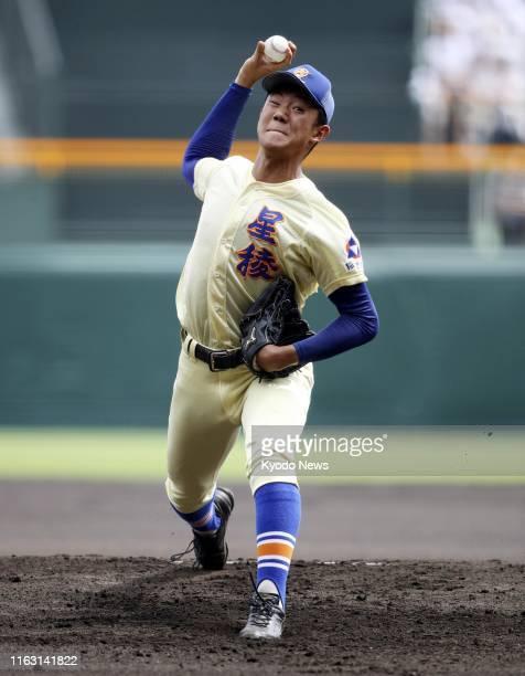 Yasunobu Okugawa of Seiryo High School pitches against Riseisha High School in the final of the 101st national high school baseball championship at...
