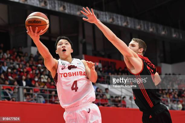 Yasunori Aoki of the Kawasaki Brave Thunders shoots while under pressure from Brendan Lane of the Alvark Tokyo during the BLeague match between...