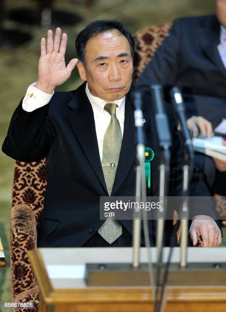 Yasunori Kagoike operator of a nationalistic school gestures before giving a sworn testimony during a session of parliament in Tokyo on March 23 2017...