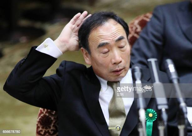 Yasunori Kagoike operator of a nationalistic school gives a sworn testimony during a session of parliament in Tokyo on March 23 2017 Japanese Prime...