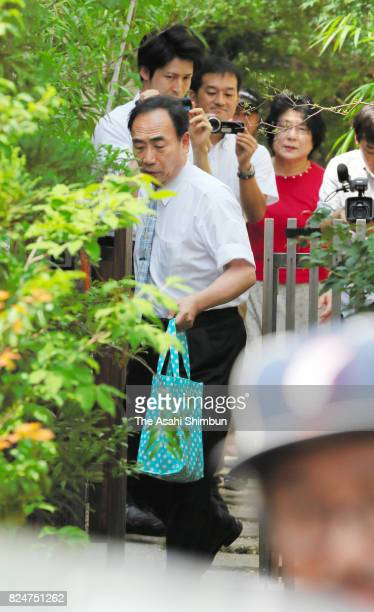 Yasunori Kagoike the former head of school operator Moritomo Gakuen leaves his home before going to speak with prosecutors on July 31 2017 in...