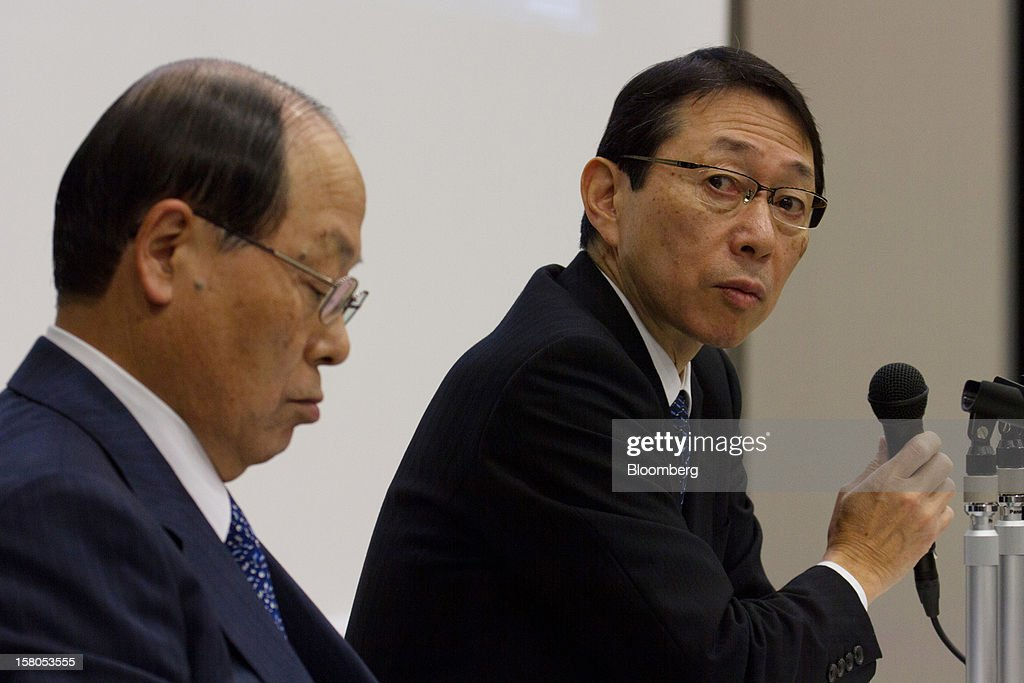 Yasushi Akao, president of Renesas Electronics Corp., right, pauses during a news conference with Kimikazu Noumi, president of Innovation Network Corp. of Japan, in Tokyo, Japan, on Monday, Dec. 10, 2012. Renesas Electronics Corp., the ailing Japanese chipmaker, will sell at least 150 billion yen ($1.8 billion) of new shares to a government-backed fund and customers such as Toyota Motor Corp. as part of a bailout plan. Photographer: Noriyuki Aida/Bloomberg via Getty Images