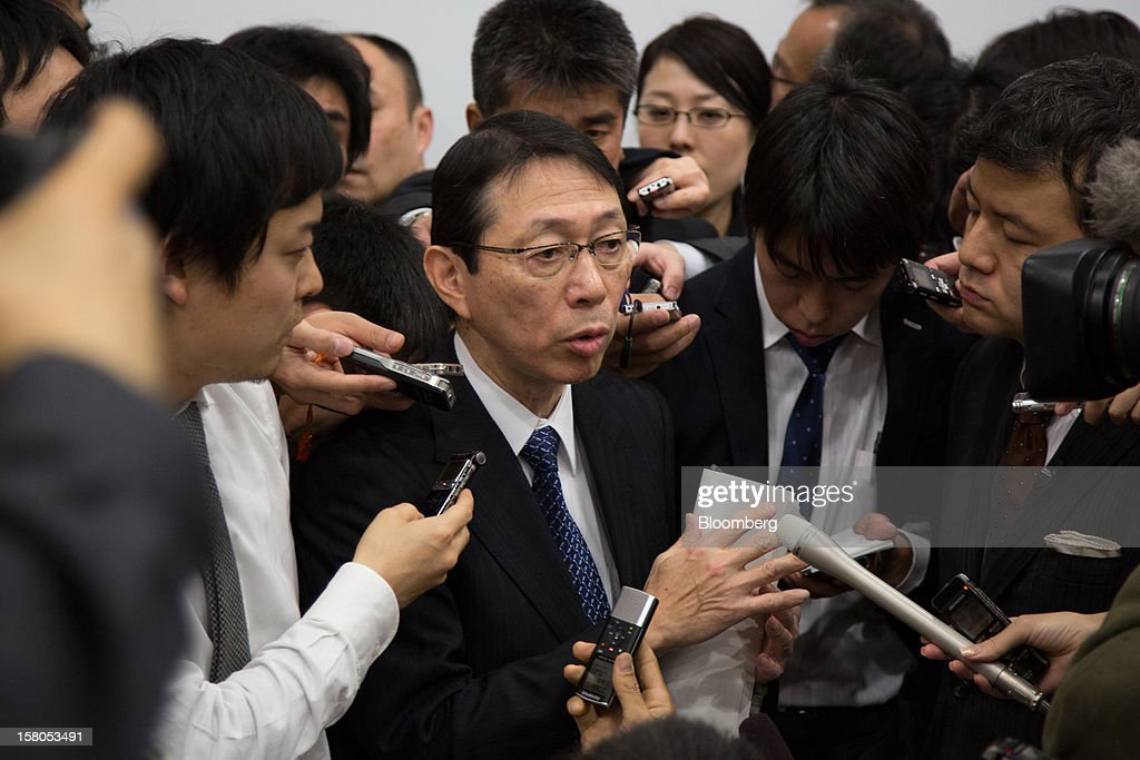 Yasushi Akao, president of Renesas Electronics Corp., speaks to reporters following a news conference in Tokyo, Japan, on Monday, Dec. 10, 2012. Renesas Electronics Corp., the ailing Japanese chipmaker, will sell at least 150 billion yen ($1.8 billion) of new shares to a government-backed fund and customers such as Toyota Motor Corp. as part of a bailout plan. Photographer: Noriyuki Aida/Bloomberg via Getty Images