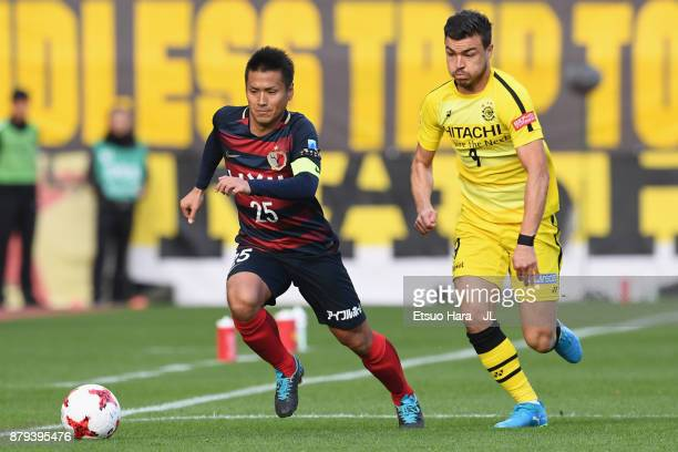 Yasushi Endo of Kashima Antlers and Cristiano of Kashiwa Reysol compete for the ball during the JLeague J1 match between Kashima Antlers and Kashiwa...