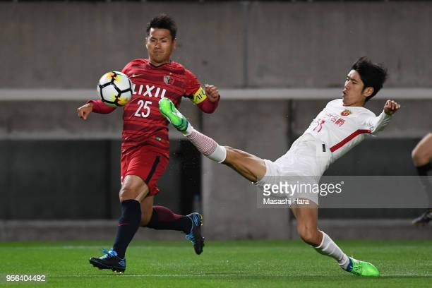 Yasushi Endo of Kashima Antlers and Lu Wenjun of Shanghai SIPG compete for the ball during the AFC Champions League Round of 16 first leg match...