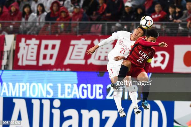 Yasushi Endo of Kashima Antlers and Yu Hai of Shanghai SIPG compete for the ball during the AFC Champions League Round of 16 first leg match between...