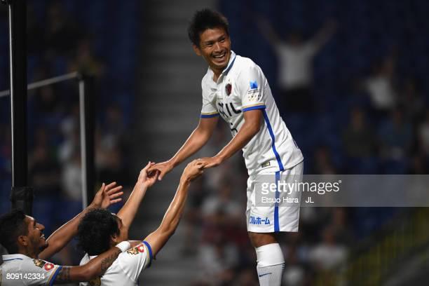 Yasushi Endo of Kashima Antlers celebrates scoring the opening goal with his team mates Mu Kanazaki and Pedro Junior during the JLeague J1 match...