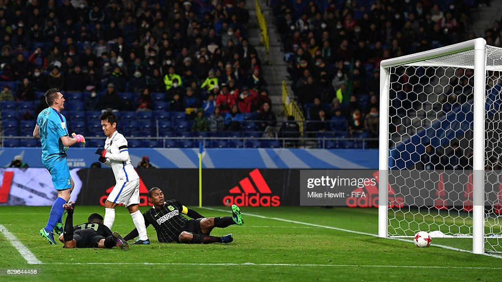 Yasushi Endo of Kashima Antlers scores his sides second goal during the FIFA Club World Cup Semi Final match between Atletico Nacional and Kashima Antlers at Suita City Football Stadium on December 14, 2016 in Suita, Japan.