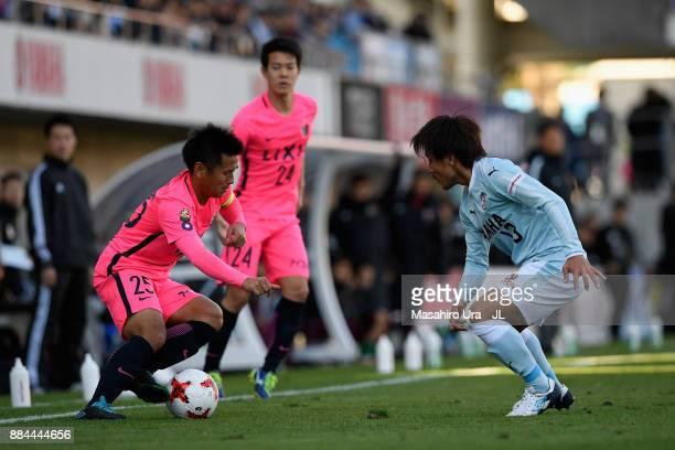 Yasushi Endo of Kashima Antlers takes on Shunsuke Nakamura of Jubilo Iwata during the JLeague J1 match between Jubilo Iwata and Kashima Antlers at...