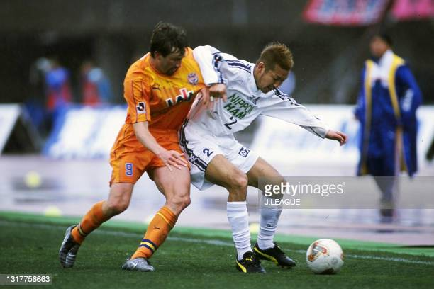 Yasushi Kita of Cerezo Osaka controls the ball under pressure of Tuto of Shimizu S-Pulse during the J.League J1 first stage match between Shimizu...