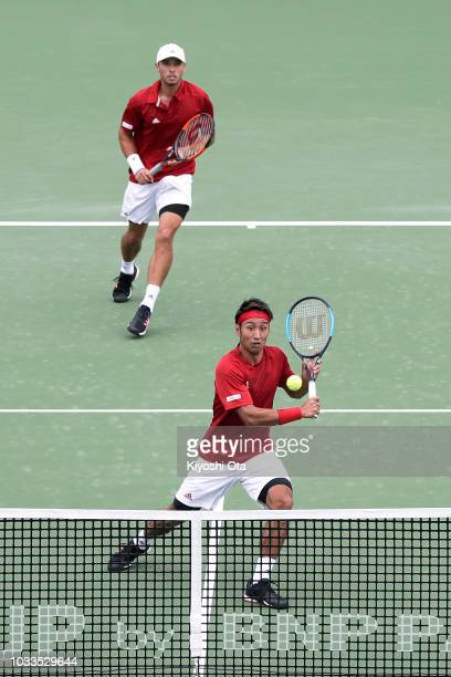 Yasutaka Uchiyama and Ben McLachlan of Japan play in their doubles match against Tomislav Brkic and Nerman Fatic of Bosnia and Herzegovina during day...