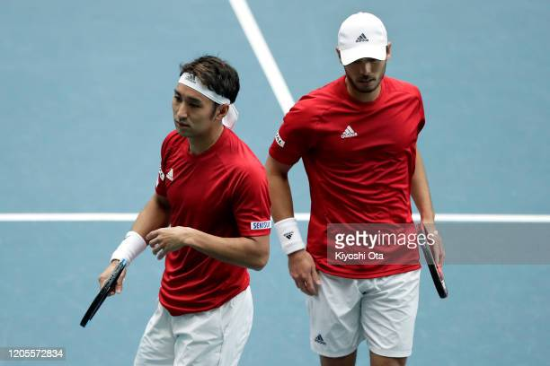 Yasutaka Uchiyama and Ben McLachlan of Japan react while playing in their doubles match against Gonzalo Escobar and Diego Hidalgo of Ecuador on day...