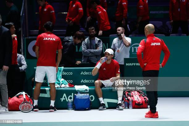 Yasutaka Uchiyama and Ben McLachlan of Japan reacts after their doubles match played against Janko Tipsarevic of Serbia and Viktor Troicki of Serbia...