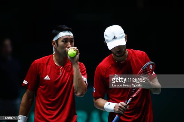 Yasutaka Uchiyama and Ben McLachlan of Japan talk during his doubles match played against Janko Tipsarevic of Serbia and Viktor Troicki of Serbia...