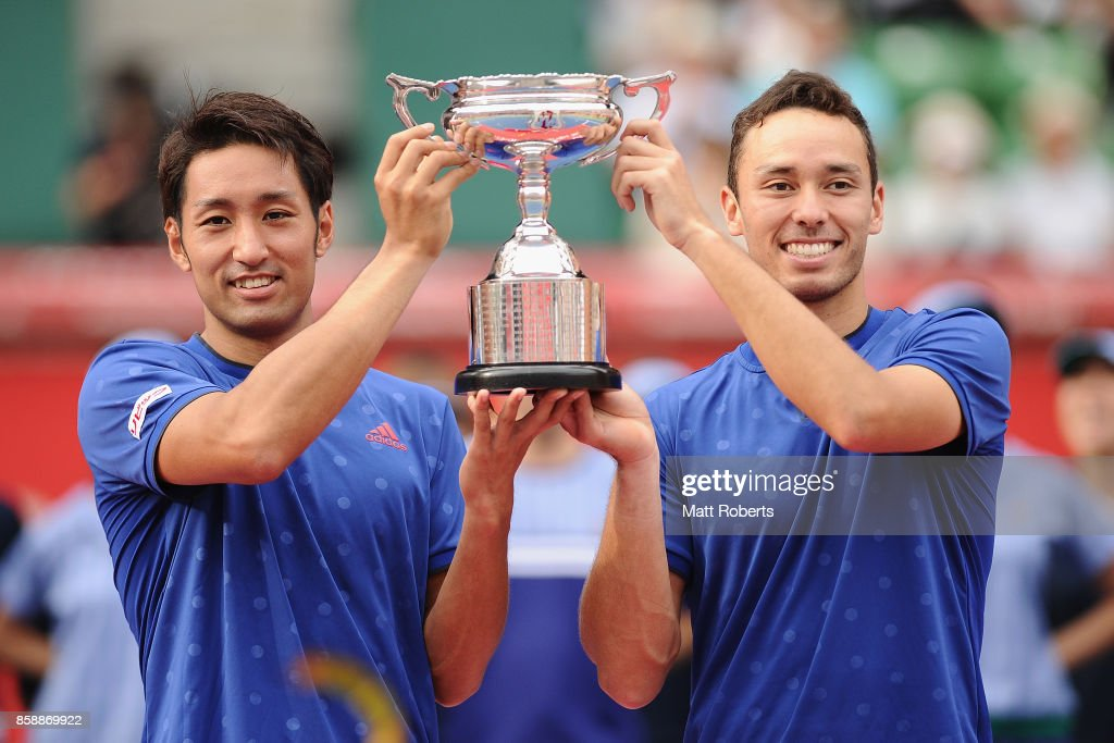 Yasutaka Uchiyama of Japan and doubles partner Ben McLachlan of Japan hold the winners trophy after their men's doubles final match against Jamie Murray of Great Britain and Bruno Soares of Brazil during day seven of the Rakuten Open at Ariake Coliseum on October 8, 2017 in Tokyo, Japan.