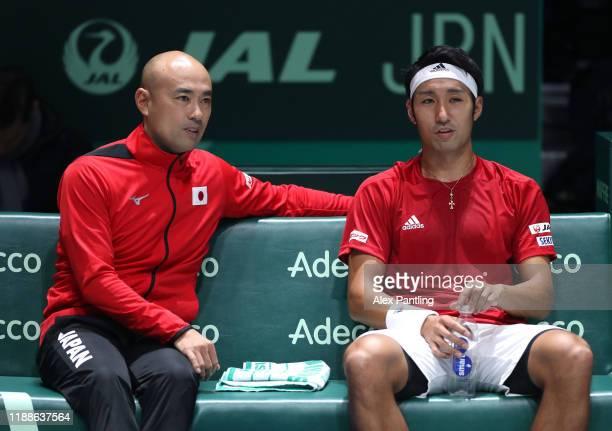 Yasutaka Uchiyama of Japan and team captain Satoshi Iwabuchi look on during Day 2 of the 2019 Davis Cup at La Caja Magica on November 19 2019 in...