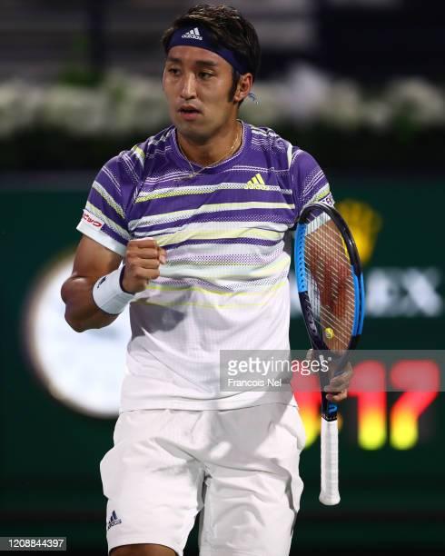 Yasutaka Uchiyama of Japan celebrates a point against Gael Monfils of France during his men's singles match on Day Ten of the Dubai Duty Free Tennis...
