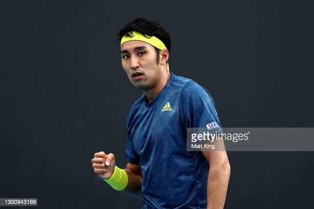 Yasutaka Uchiyama of Japan celebrates after winning a point in his Men's Singles first round match against Ugo Humbert of France during day one of...