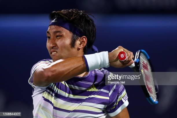 Yasutaka Uchiyama of Japan in action against Gael Monfils of France during his men's singles match on Day Ten of the Dubai Duty Free Tennis at Dubai...