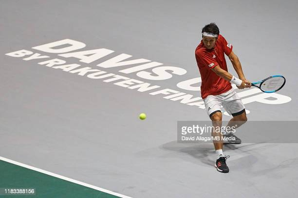 Yasutaka Uchiyama of Japan in action during his match against JoWilfried Tsonga of France during Day two of the 2019 Davis Cup at La Caja Magica on...