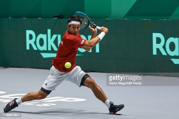 Yasutaka Uchiyama of Japan in action during his match against Jo-Wilfried Tsonga of France during Day two of the 2019 Davis Cup at La Caja Magica on...