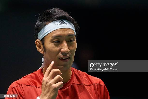 Yasutaka Uchiyama of Japan looks on during his match against JoWilfried Tsonga of France during Day two of the 2019 Davis Cup at La Caja Magica on...