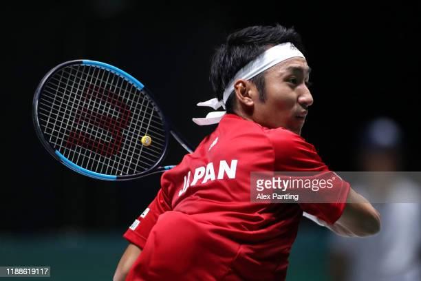 Yasutaka Uchiyama of Japan plays a backhand during Day 2 of the 2019 Davis Cup at La Caja Magica on November 19 2019 in Madrid Spain