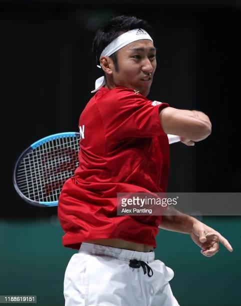 Yasutaka Uchiyama of Japan plays a backhand during Day 2 of the 2019 Davis Cup at La Caja Magica on November 19, 2019 in Madrid, Spain.